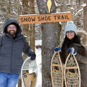 Harsh and Lovleen Goyal, who moved to Sault Ste. Marie from New Delhi, embraced Canada's winter weather, learning to snowshoe and exploring the ice caves on Lake Superior.